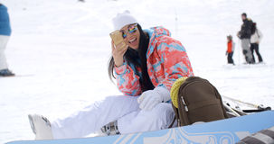 Happy young woman posing for a selfie in the snow royalty free stock photo