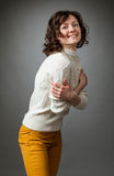 Happy young woman posing in a studio Royalty Free Stock Image