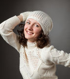 Happy young woman posing in a studio wearing in a sweater and mi Royalty Free Stock Image