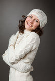 Happy young woman posing in a studio wearing in a sweater and mi Royalty Free Stock Photos