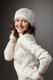 Happy young woman posing in a studio wearing in a sweater and mi Royalty Free Stock Images