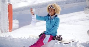 Happy young woman posing for a winter selfie stock footage