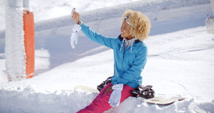 Happy young woman posing for a winter selfie Stock Photography