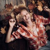 Happy young woman are preparing for autumn sunny day. Funny fac . Smile girl lies on wooden background and dreams of. Warm autumn. Black friday shopping. Top stock images