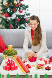 Happy young woman preparing Christmas gift Stock Image