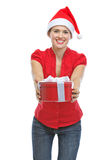 Happy young woman presenting Christmas gift box Royalty Free Stock Photo