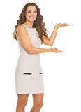 Happy young woman presenting something Royalty Free Stock Photo