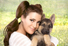 Happy Young Woman with a Puppy Dog Royalty Free Stock Image