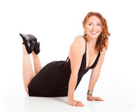 Happy young woman in push-up pose Stock Photo