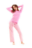 Happy young woman in pyjamas Royalty Free Stock Image