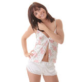 Happy young woman in pyjamas Stock Photography
