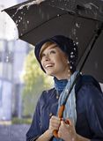 Happy young woman in the rain Stock Image