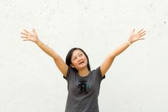 Happy young woman raise and spread arms Royalty Free Stock Photo