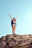 Happy young woman with raised hands Stock Photos