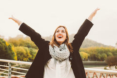Happy young woman raising arms Royalty Free Stock Photo
