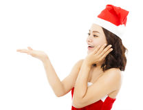 Happy young woman raising hand to show something Stock Photo