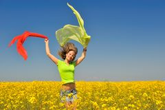 Happy young woman on rape field Royalty Free Stock Images