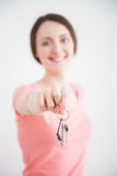 Happy young woman reaching out bunch of keys Royalty Free Stock Photos
