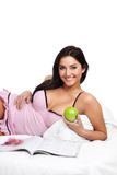 Happy young woman in read bed Royalty Free Stock Image