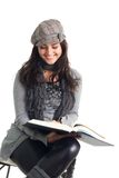 Happy young woman read book Stock Image