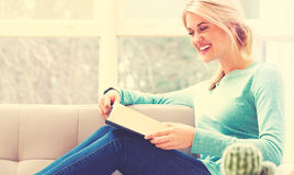 Happy young woman reading a book Royalty Free Stock Photo