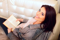 Happy young woman reading a book Stock Photography