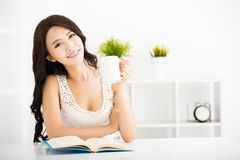 Happy young woman reading book Stock Photography