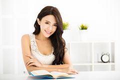 Happy young woman reading book Royalty Free Stock Photo