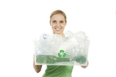 Happy young woman recycling. Happy young woman with recycling bin Stock Photos
