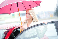 Happy Young Woman And Red Car Stock Photos