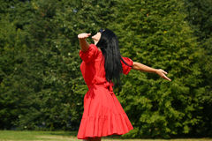 Happy young woman in red dress Royalty Free Stock Images