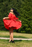Happy young woman in red dress Stock Photography
