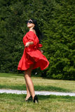 Happy young woman in red dress Royalty Free Stock Photo