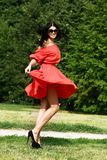 Happy young woman in red dress Royalty Free Stock Photos