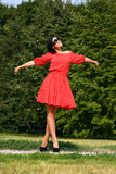 Happy young woman in red dress Stock Photo