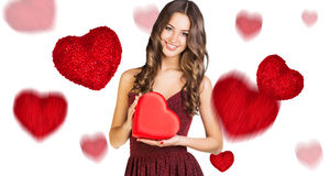 Happy young woman with red heart box stock images