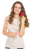 Happy young woman with red rose Royalty Free Stock Photography