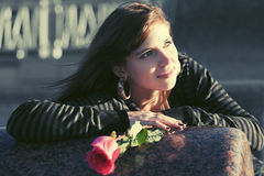 Happy young woman with a red rose outdoor Stock Image