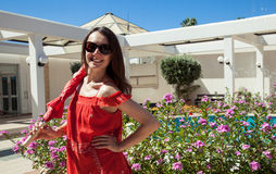 Happy young woman in red sundress with umbrella Stock Photography