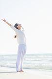 Happy young woman rejoicing at seaside Royalty Free Stock Image