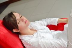 Happy young woman relax at home on sofa Royalty Free Stock Photo