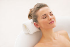 Happy young woman relaxing in bathtub royalty free stock photo