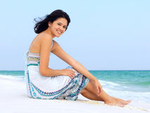 Happy Young Woman Relaxing on a Beach Royalty Free Stock Photography