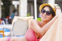 Young Woman Relaxing on the Beach. Happy young woman relaxing on the beach. Summer vacation Royalty Free Stock Photography