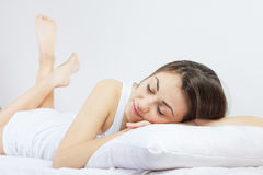 Happy young woman relaxing Royalty Free Stock Image