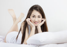 Happy young woman relaxing Stock Photo