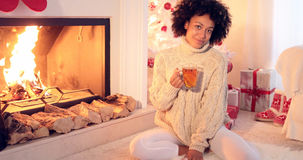 Happy young woman relaxing at Christmas Stock Images