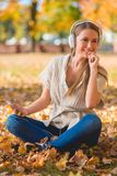 Happy young woman relaxing with her music Stock Image