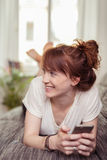 Happy young woman relaxing at home Stock Photography