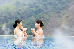 Happy young woman relaxing in  hot springs. Happy young asian women relaxing in  hot springs Royalty Free Stock Photography
